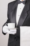 Waiter Holding Coffee Cup and Towel Stock Photos