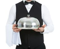 Waiter holding domed tray Royalty Free Stock Image
