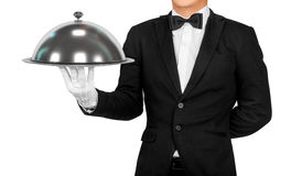 Waiter holding empty silver tray. Isolated on white background royalty free stock photography
