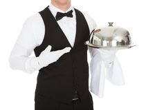 Waiter Holding Empty Silver Tray. Over White Background stock photos