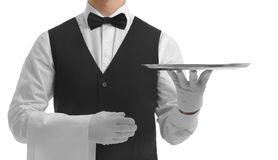 Waiter holding empty silver tray. On white background stock photos