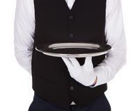 Waiter holding empty tray Stock Photos