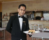 Waiter holding food Royalty Free Stock Photography