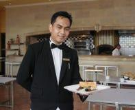 Waiter Holding Food Royalty Free Stock Photography