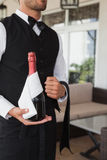 Waiter holding magnum of champagne Royalty Free Stock Image