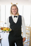 Waiter holding a plate of food in restaurant Royalty Free Stock Photography