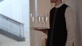 Waiter holding plate with glasses of champagne. At the party stock video footage