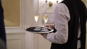 Waiter holding plate with glasses of champagne. At the party stock video