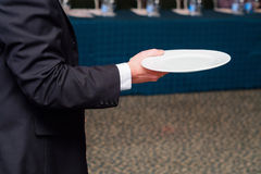 Waiter is holding plate Stock Photography