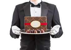 Waiter holding silver platter Royalty Free Stock Images