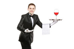 Waiter holding a silver tray. With a glass of wine on it isolated on white background stock photos