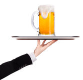 Waiter holding silver tray with beer Stock Photo