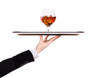 Waiter holding silver tray with brandy Stock Photography