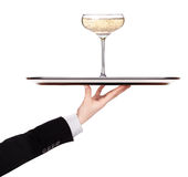 Waiter holding silver tray with champagne. Waiter holding  silver tray with champagne isolated on a white background Stock Photography
