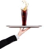 Waiter holding silver tray with soda stock photo
