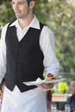Waiter Holding Slice Of Pie At Cafe Royalty Free Stock Photography