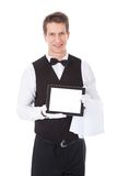 Waiter holding tablet pc Stock Images