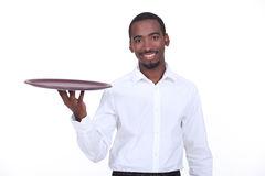 Waiter holding tray Stock Photography