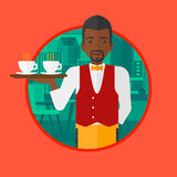 Waiter holding tray with cups of coffeee or tea. Royalty Free Stock Images
