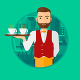 Waiter holding tray with cups of coffeee or tea. Royalty Free Stock Image