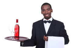 Waiter holding a tray. With a drink on it stock image