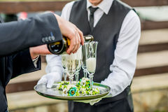 Waiter holding tray with glasses Royalty Free Stock Image