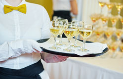 Waiter holding a tray with glasses of vine Royalty Free Stock Photo