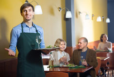 Waiter holding a tray in his hand in the restaurant Royalty Free Stock Photo