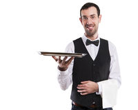 Waiter holding tray. Isolated over white background. Smiling butler Royalty Free Stock Images