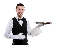 Waiter holding tray. Isolated over white background. Smiling but Royalty Free Stock Image