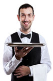 Waiter holding tray.  over white background. Smiling butler Royalty Free Stock Photo