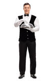 Waiter holding a tray with plastic lid Stock Photos