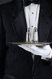 Waiter Holding Tray with Salt and Pepper royalty free stock image