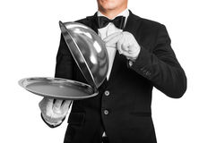 Waiter holds tray with metal lid Stock Photography