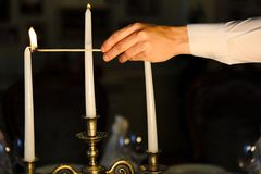 Waiter lights a candle. Wedding Day. the waiter lights a candle. romantic dinner Royalty Free Stock Images