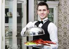 Waiter. With lobster on a plate in a restaurant Stock Image