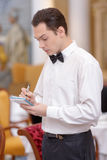 Waiter In the luxury restaurant Royalty Free Stock Photo