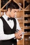 Waiter making notes. Royalty Free Stock Photo