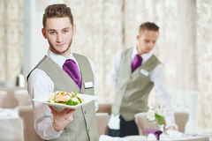 Waiter man in restaurant Stock Images