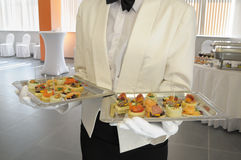 Waiter at a meeting of visitors. Royalty Free Stock Photos