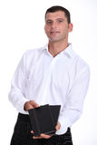 Waiter with menus Royalty Free Stock Photography