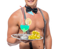 Waiter with a naked torso holding a cocktail Royalty Free Stock Image