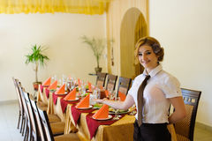 Waiter near the table with food Stock Image