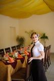Waiter near the table with food Stock Photos