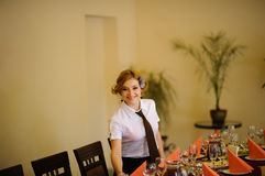 Waiter near the table with food Stock Photo