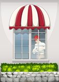A waiter near the window Royalty Free Stock Photography