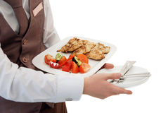 Waiter is offering grilled meat and vegetables Royalty Free Stock Photography