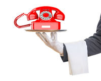 Waiter offering a red old telephone. 3d illustration Royalty Free Stock Images