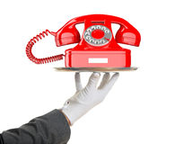Waiter offering a red old telephone. 3d illustration Royalty Free Stock Photos