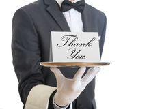 Waiter offering a tray with a Thank you card royalty free stock photos